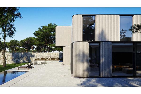 Современный дом с закругленными фасадами